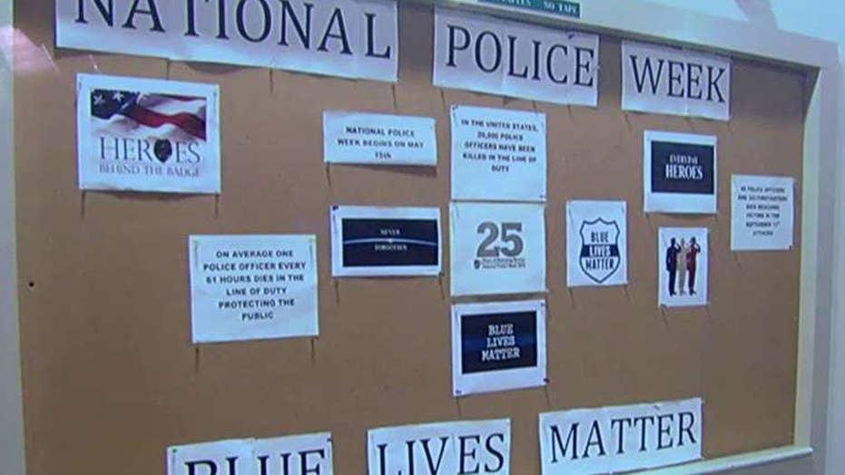 Campus controversy over defacing of pro-police display