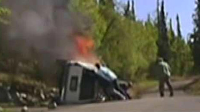 Incredible rescue: Cops, citizens lift burning truck off man