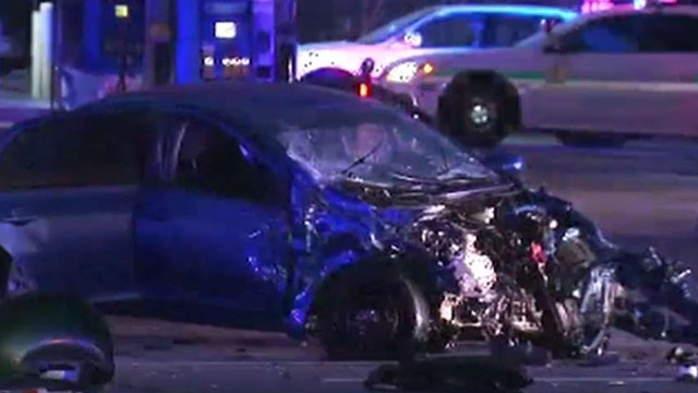 Video: Cop slams into car after blowing through red light