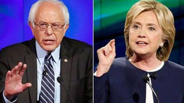 Clinton calls for party unity as Sanders vows to fight on