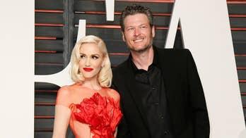 Blake Shelton steals a kiss with Gwen Stefani at Luke Bryan concert