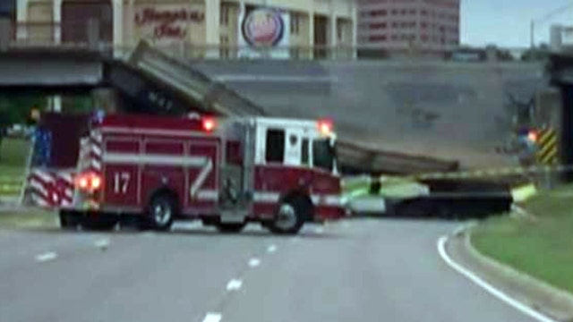 Crews rescue driver after bridge collapses onto his truck