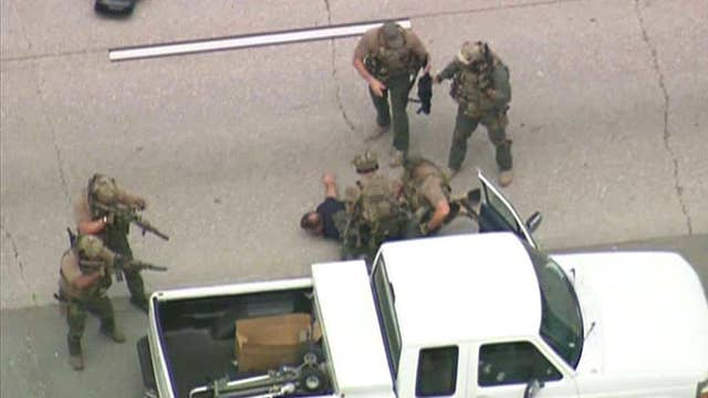 Police swarm suspect to end armed standoff
