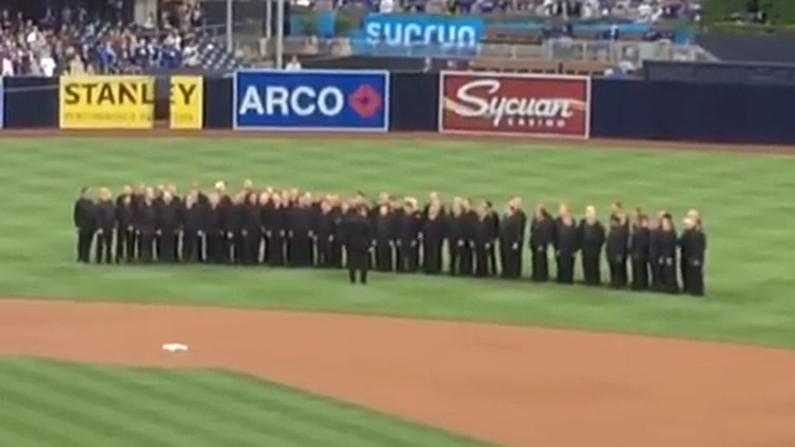 Raw video: Recorded voice of a woman singing the anthem plays while 100 chorus members stand on field waiting to perform. San Diego Padres apologize for 'mistake'
