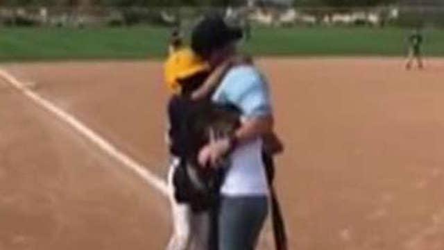 Marine surprises kids at baseball game