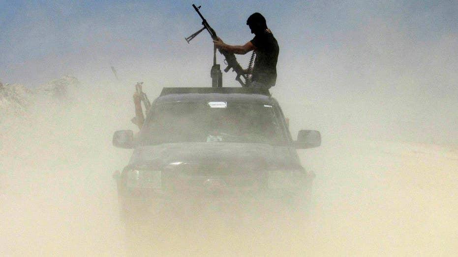 Iraqi troops battle ISIS militants in bid to retake Fallujah