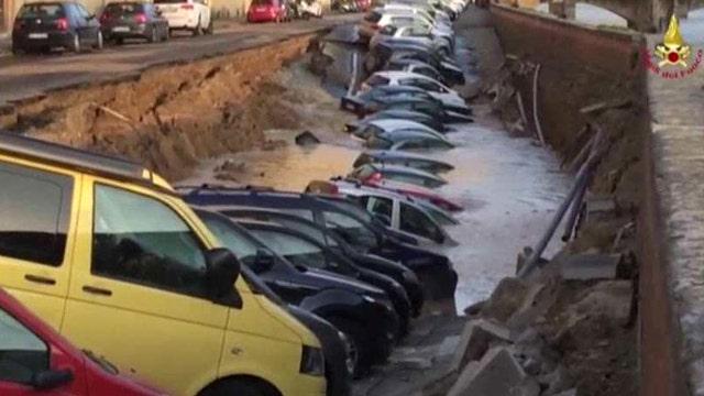 Massive sinkhole swallows dozens of cars