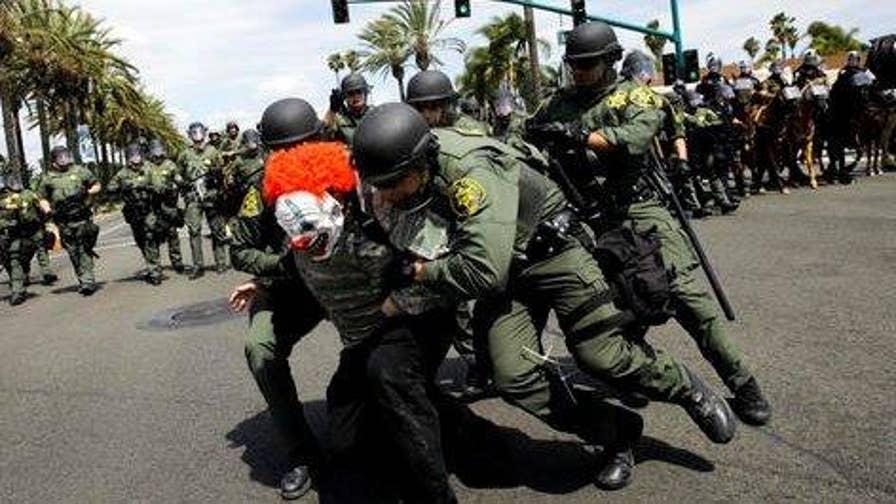 Police confront anti-Trump protesters in Anaheim