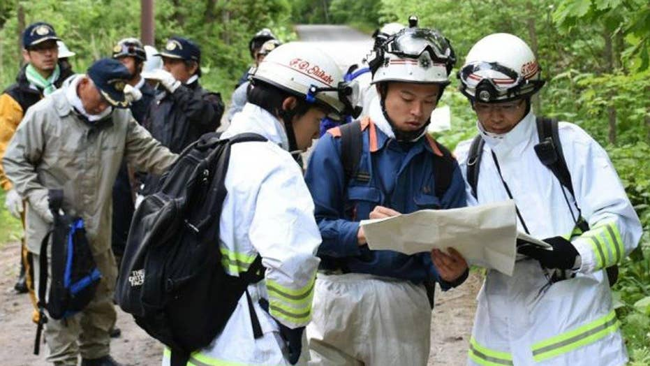 Rescue workers in Japan search for 7-year-old left in forest