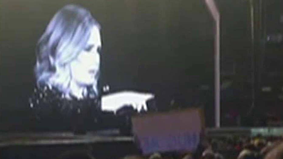 Adele calls out fan for filming concert