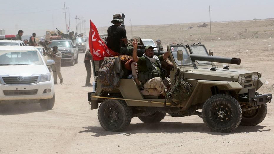 Iraqi forces battling ISIS surround Fallujah
