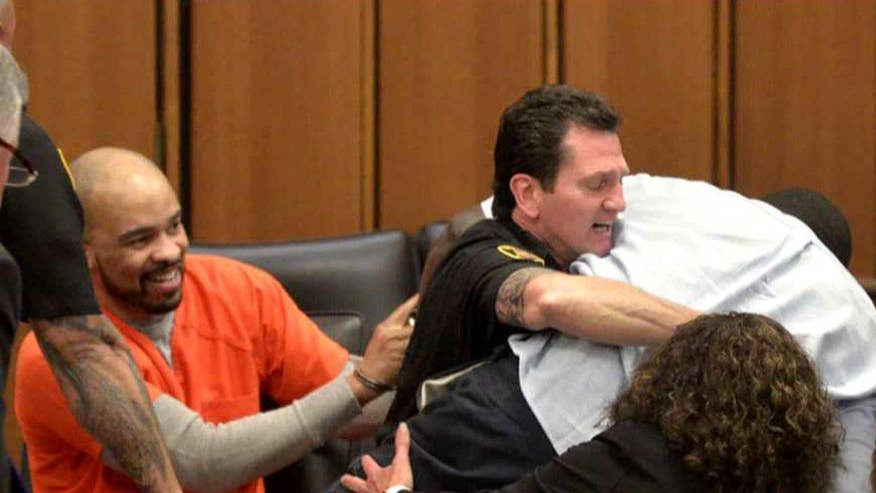 Father attacks daughter's killer in Cleveland courtroom