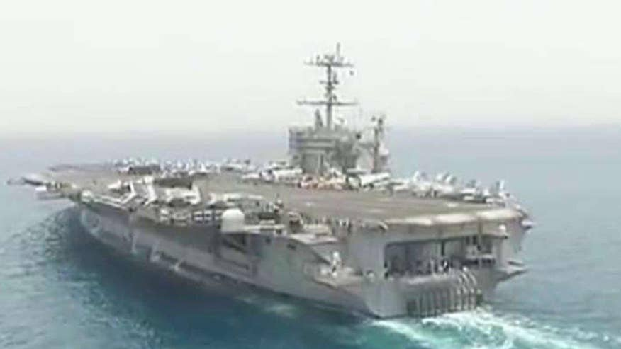U.S. Navy fighter flying missions from aircraft carrier in the Mediterranean Sea