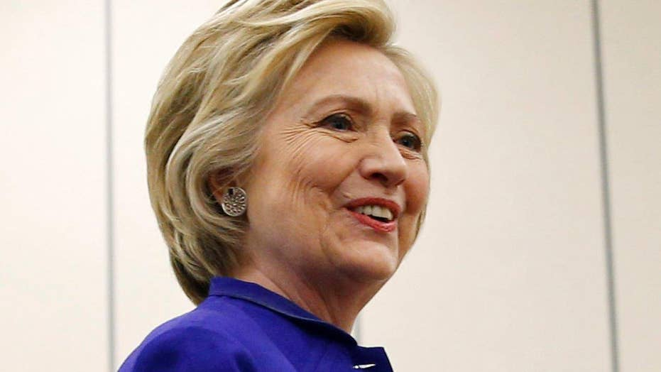 Hillary Clinton talks to press at campaign stop in Calif.