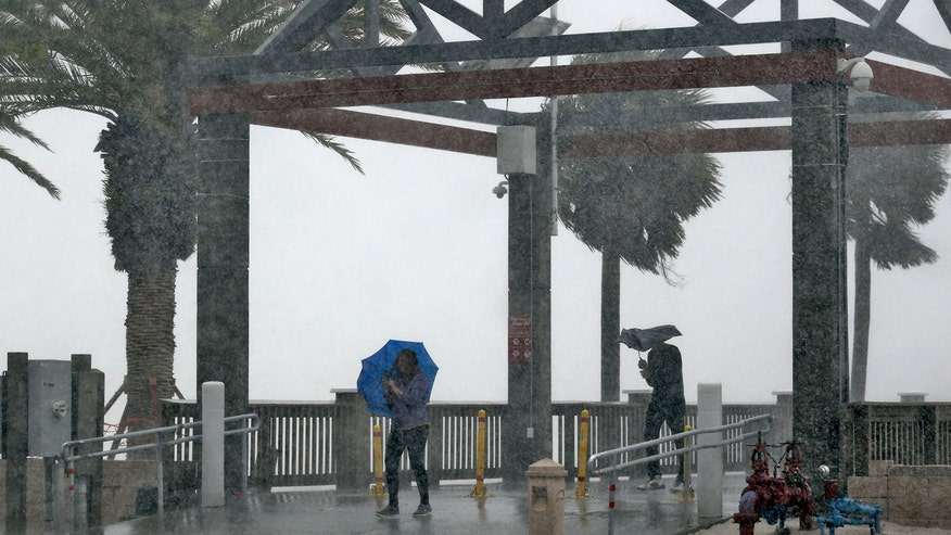 Tropical storm crosses Florida peninsula, heading up the east coast
