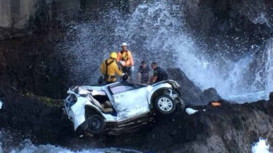 Woman driving a vehicle when it plunged off cliff in Hawaii charged with second-degree murder in death of her sister