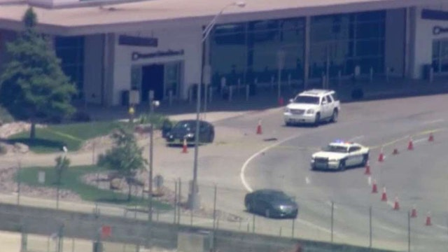 Shots fired at Dallas Love Field as bystanders look on