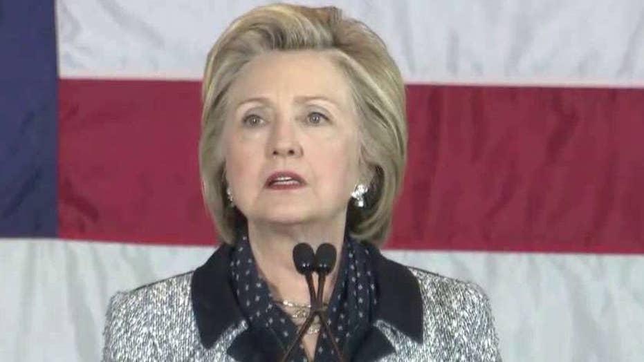 Clinton blasts Trump for his rhetoric against Obama