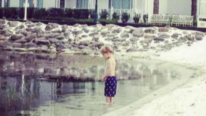 Child played in the water at the Disney resort an hour before Lane Graves was killed