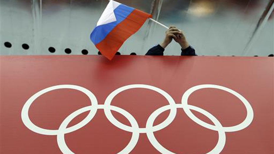 Russian track and field team banned from Olympics for doping