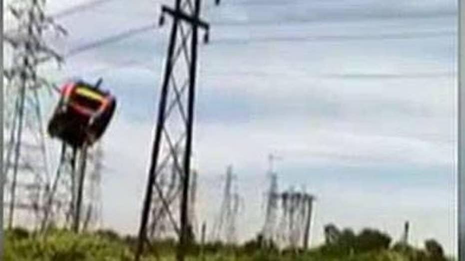 Video: Bounce house flies away, slams into power lines