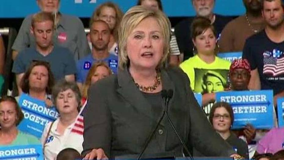 Clinton pushes for party unity as she touts economic plan