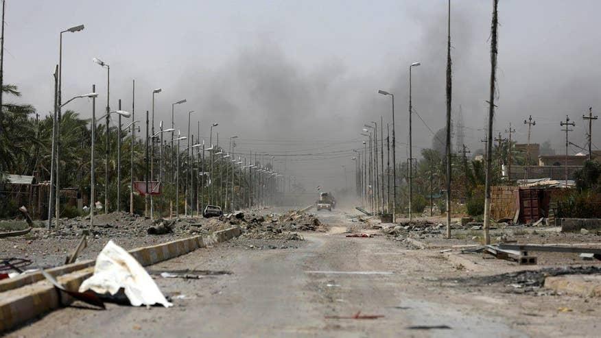 Iraqi troops retake city after month-long combat blitz