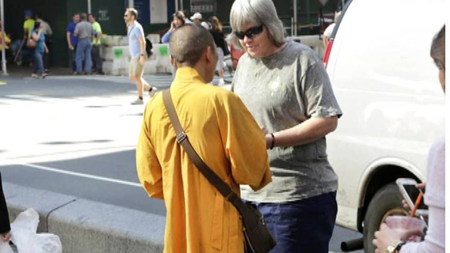 Buddhist Council of New York warns tourists of imposters in Times Square