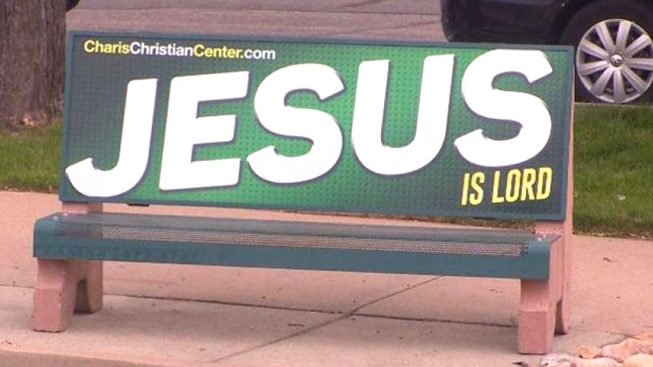 Pastor battles city over Jesus-related bus stop bench ads