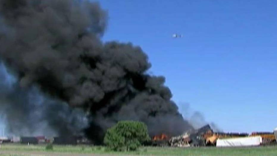 Two trains collide head-on in fiery crash