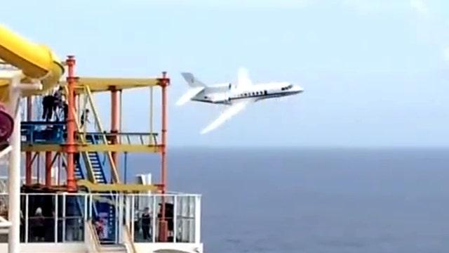 Military jet buzzes cruise ship in the Atlantic Ocean
