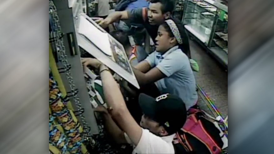 Raw video: Security camera captures group raid store's shelves in Caracas