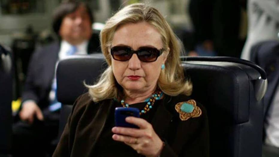 Should Clinton be charged or cleared in email probe?