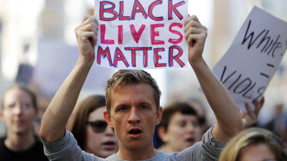 Thousands attend protests against police shootings