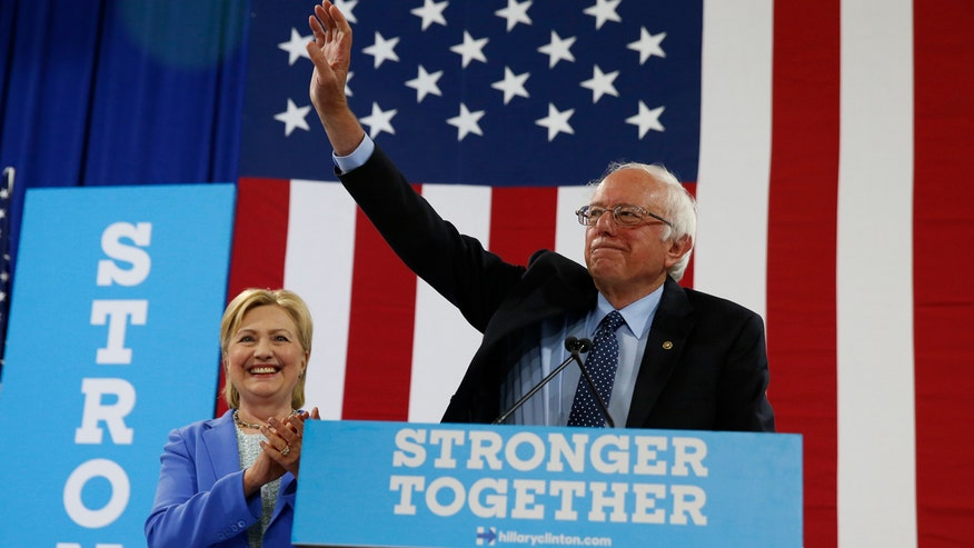 Bernie Sanders campaigns with the presumptive Democratic presidential nominee in Portsmouth, New Hampshire