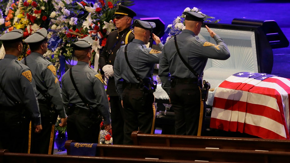 Hundreds mourn slain Dallas officers at funeral services