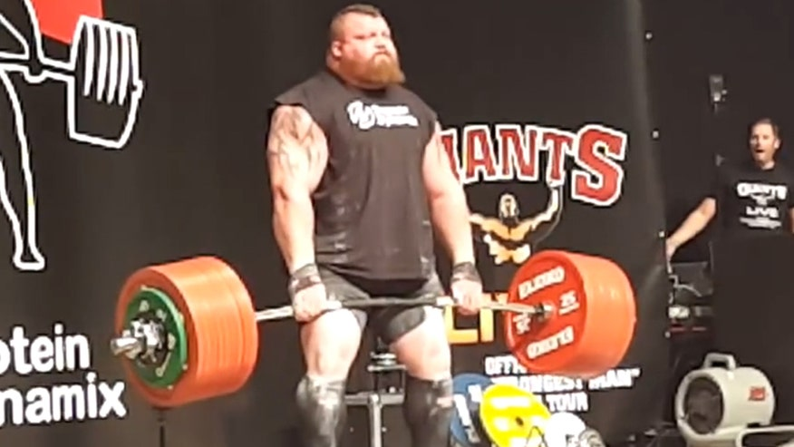 Raw video: Eddie Hall slumps to ground after becoming first man in world to deadlift 500kg or 1102.31lbs