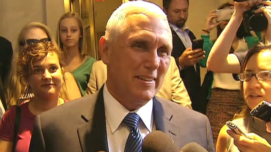 Indiana governor speaks to reporters as he departs New York hotel