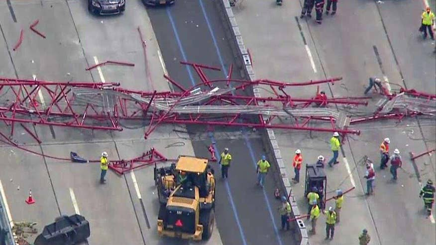 Injuries reported, traffic blocked after construction crane falls on bridge outside New York City