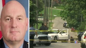Officer was shot and killed while responding to a drive-by shooting, two suspects are in custody