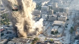 Raw video: Syrian opposition group shares footage of fighters setting up explosive devices in underground tunnel before huge blast destroys building