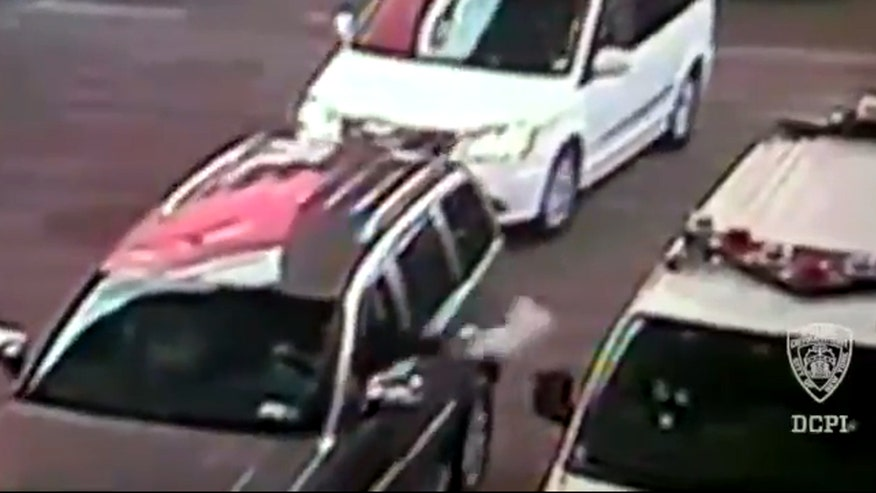 Raw video: Surveillance camera captures moment suspect throws object into NYPD vehicle