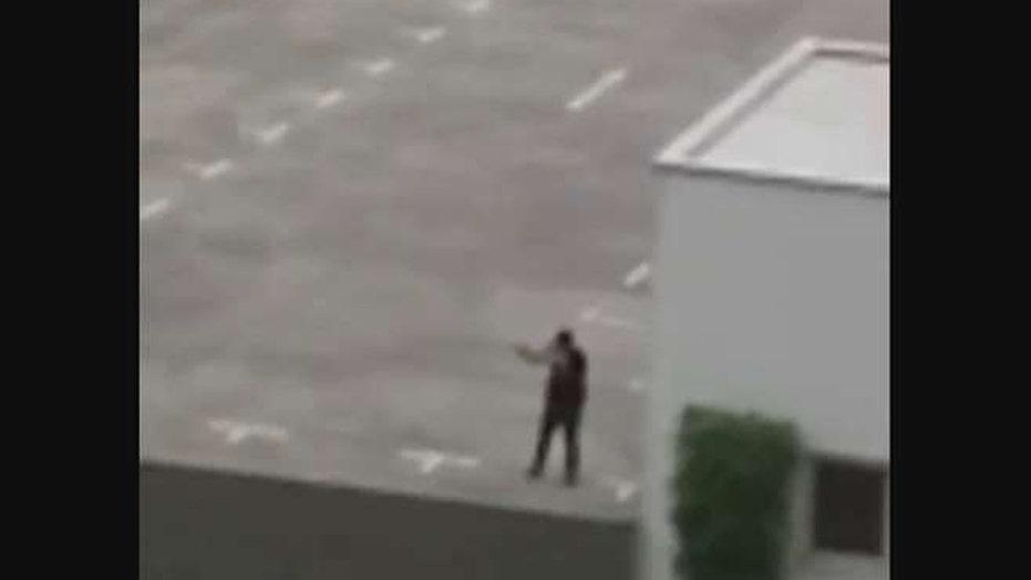 Video: Gunman opens fire on rooftop parking lot in Munich