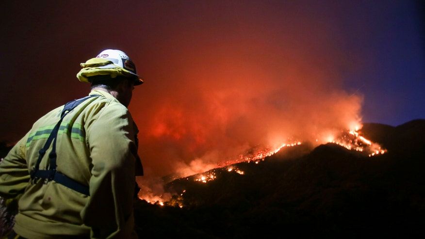 Raging inferno destroys 18 homes in Los Angeles county