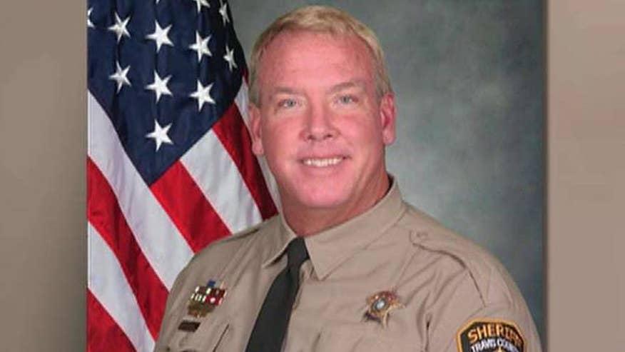 Deputy shot in his own backyard