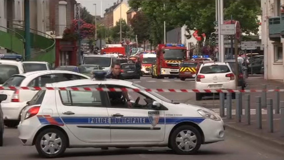 Two men killed by police after taking hostages in France