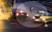 Raw video: Biker rides away safely after driver who ran red light and appeared to be on collision course with cyclist was hit by taxi