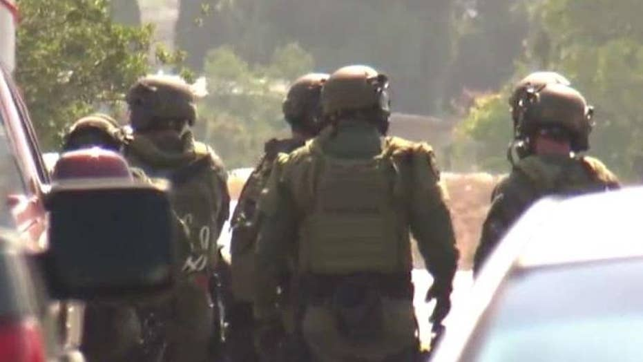 SWAT team surrounds 2nd San Diego shooting suspect's home