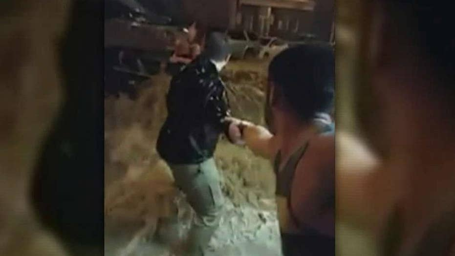 Human chain forms to save woman from rising flood waters