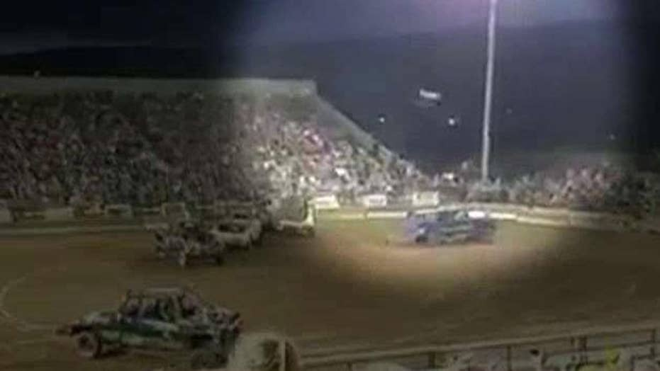 Flying car part injures spectators at demolition derby